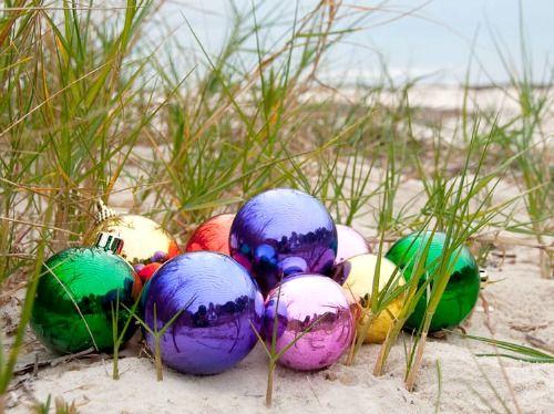 Christmas Ball Ornaments on the Beach... Featured on Beach Bliss Living: http://beachblissliving.com/beach-christmas-card-photo-ideas/ Photo by Ken Butler.