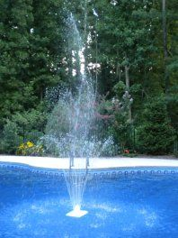 A floating pool fountain provides a soothing sound and a refreshing view.