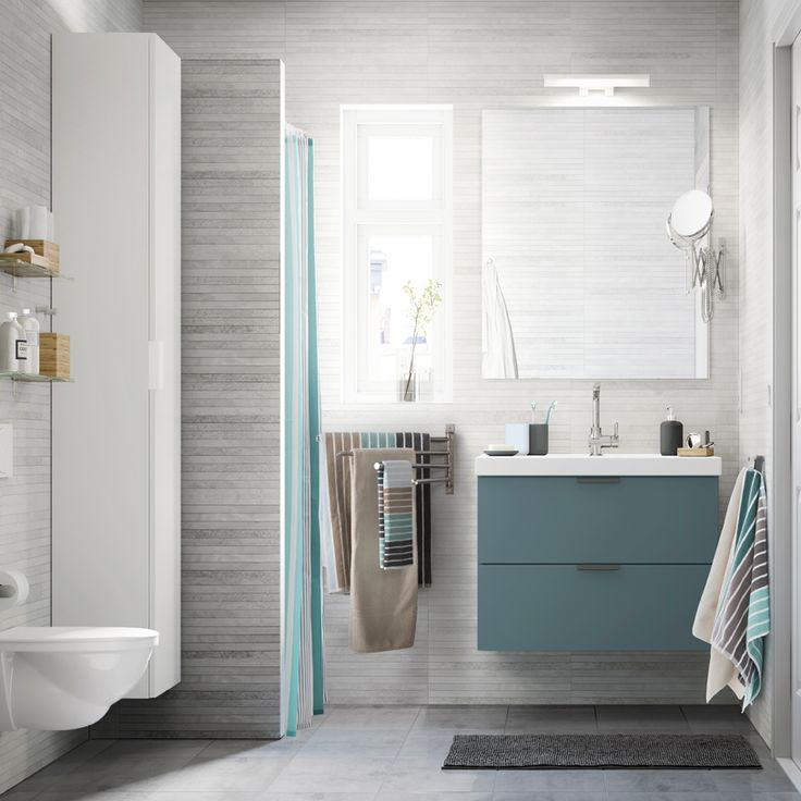 Ikea: A Light Grey Small Bathroom With A White High Cabinet, A Mirror And A  Grey Wash Stand With Two Drawers.
