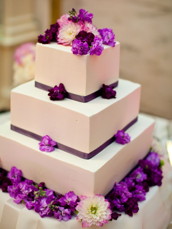 wedding_cakes - This is a white cake with a buttercream frosting. The purple decoration is outstanding!