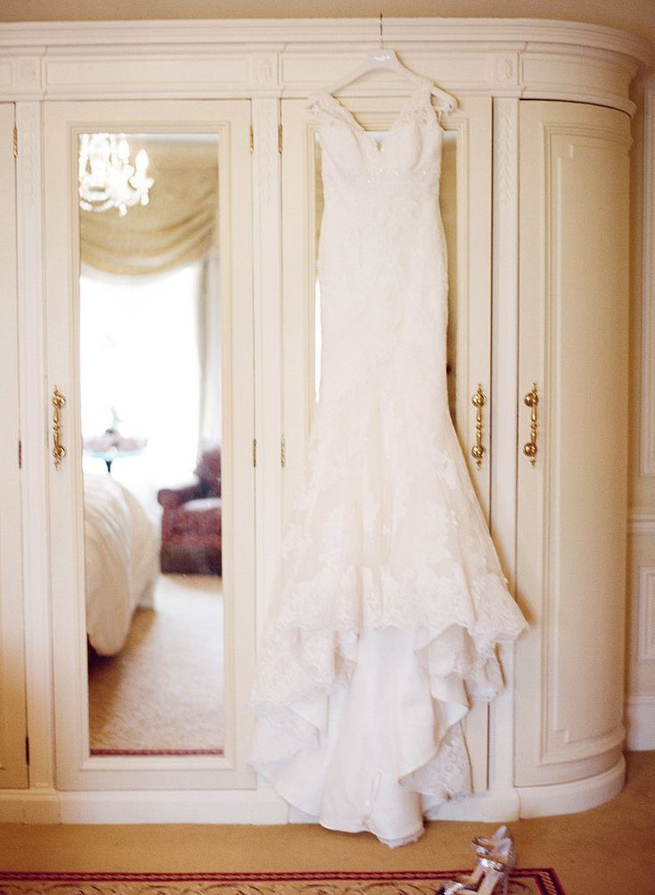 There's a reason on-hanger shots are so popular! The styled pictures evoke the calm before the storm and don't let anything compete with the dress. Photo by Aneta Mak via Style Me Pretty
