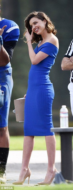 Figure-hugging: The 33-year-old beauty looked amazing in an electric blue off-the-shoulder...