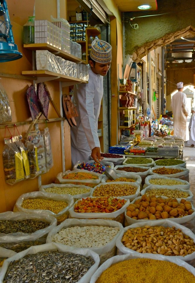 "Nizwa Souk: ""If you want to see the old Nizwa however, this façade is just that, and a few more steps will take you beyond to the medieval mud streets ripe with the usual medieval smells. Spices, seeds, berries, herbs and all sorts of intriguing produce used in traditional medicinal remedies can be bought here."" Oman: The Bradt Guide www.bradtguides.com"