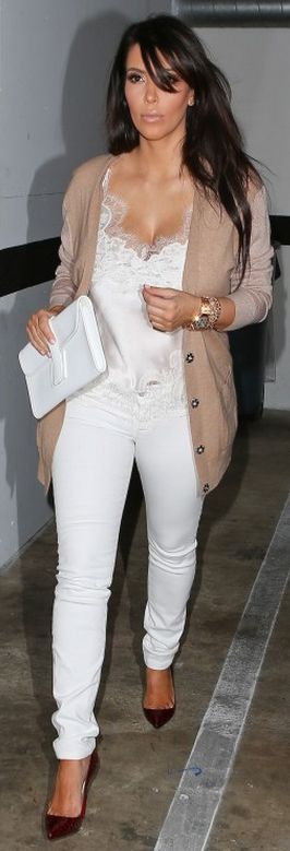 Kim Kardashian: Jeans – J Brand    Shirt – Carine Gilson    Sweater – Dries van Noten    Shoes – Christian Louboutin    Purse – Hermes