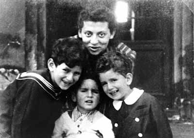 As appalling as conditions were in the Warsaw Ghetto, some of the city's Jews survived, often by hiding outside the ghetto in the homes of gentiles who were willing to conceal them. Here, Jacob, David, and Shalom Gutgeld pose with their Aunt Janke. Janke managed to get the three boys out of the ghetto, hiding them in the small apartment of a couple named the Roslans. Jacob and David survived the Holocaust, but Shalom died of scarlet fever.
