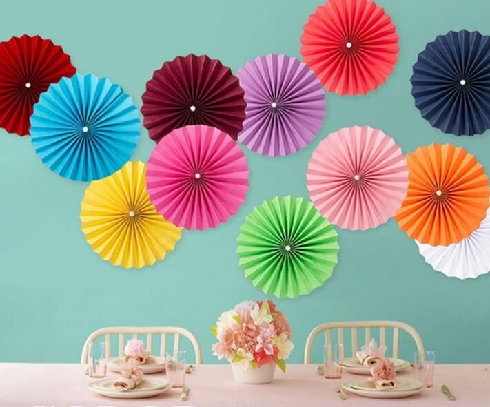 Decorate your walls with tissue paper pinwheels! You can use one solid color or use several colors! it really depends on your liking and theme
