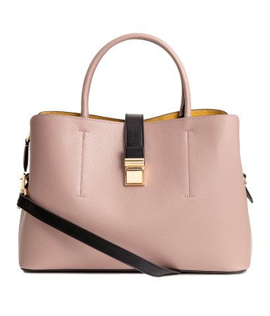 Powder. Handbag in grained imitation leather with two handles, a narrow, detachable shoulder strap, tab and metal fastener at top, and studs at base. Two