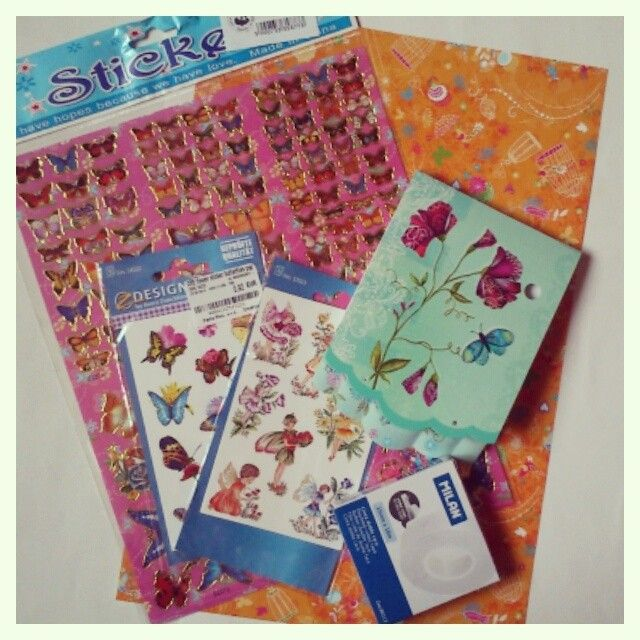 butterfly stickers, tape, notebook