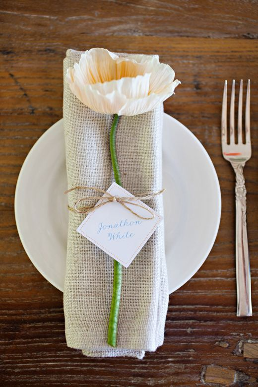 Paper flower and burlap napkin tied together with a rope string....so genious