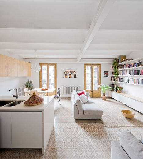 Barcelona apartment by Bach Arquitectes with colourful floor tiles arranged in stripes