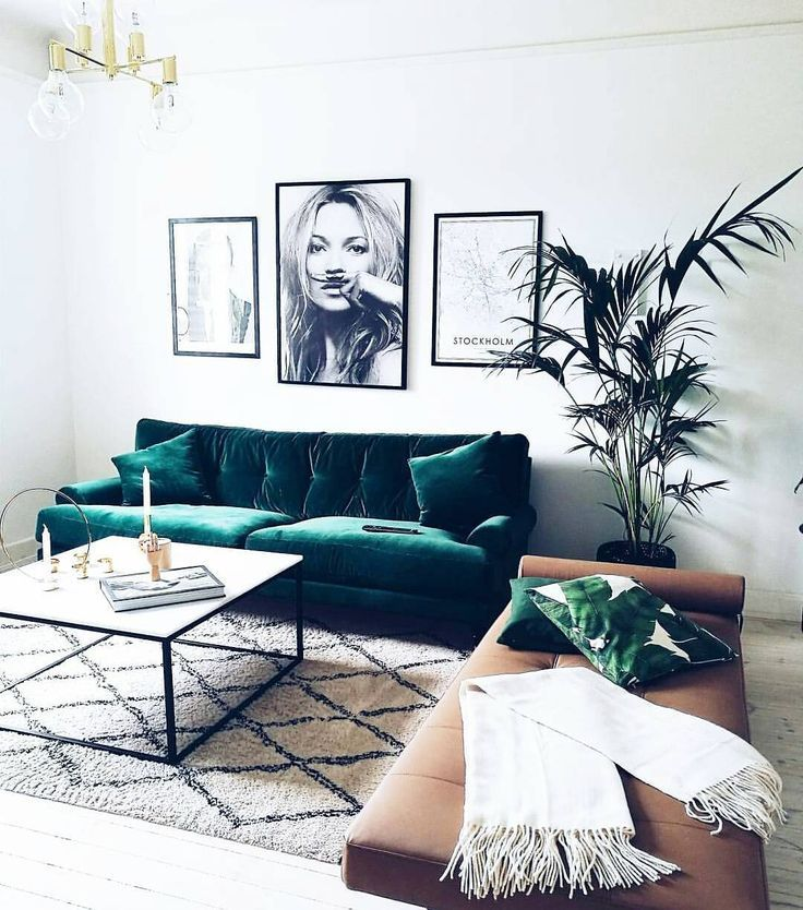 Boho-inspired living space with black & white art and green accents