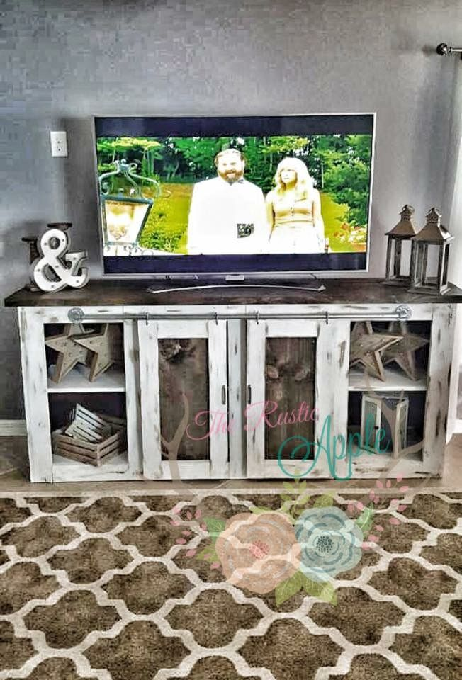 Rustic meets industrial media stand. Plumbing pipe sliding barn doors. Finished with chalk paint and distressed to give an aged look. TV console.