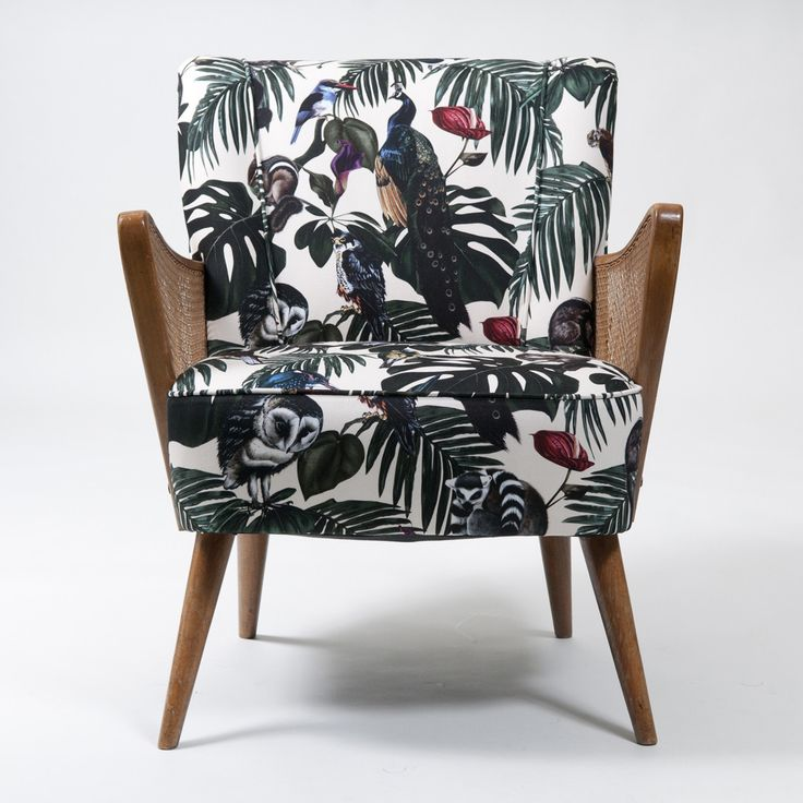 Retro Scandinavian Chair upholstered in Amazonia Light Fabric by Witch and Watchman in Velvet and Cotton Featuring tropical palm leaves, cheese plants, fern leaves, peacocks, lemurs, owls and other birds and animals!