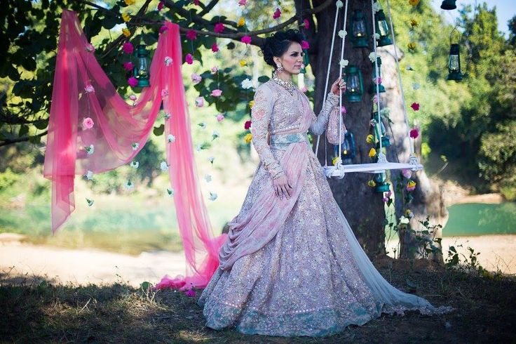 A heavily embellished Gold lehenga with a mint green border and a printed belt & dupatta by Sabyasachi for Bride Nikhita Bhate of WeddingSutra. Photo Courtesy- Sutra Snapperz - The Wedding Photography Co.