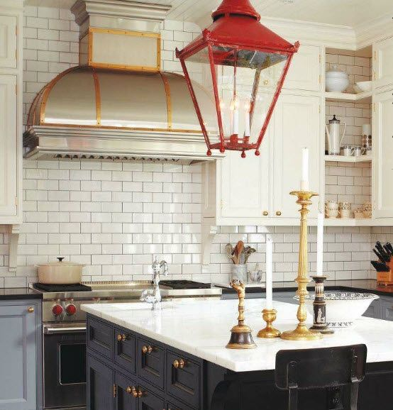 I love so many details in this kitchen.. subway tile, island, range hood! range cabinet colors, brackets on upper cabinets, countertops.