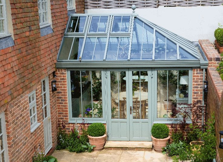 Small hipped conservatory on a listed cottage