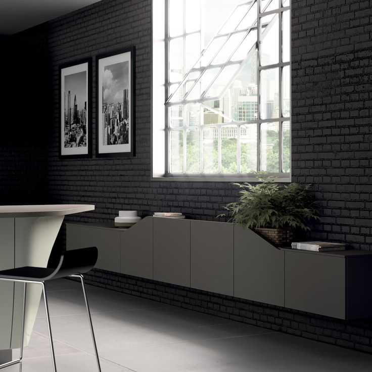 New shaped Titanium Grey matt doors markthe space rhythmically in keeping with the details of the model.