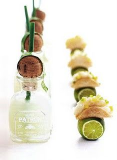 Mini patron bottle margaritas, accompanied by mini tacos with lime