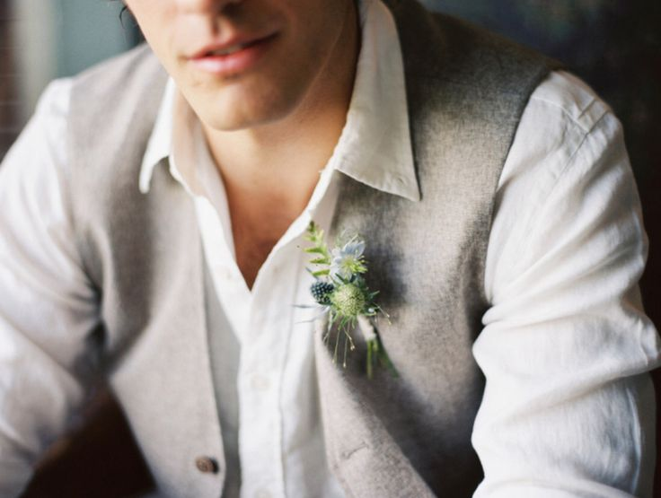 groom's boutonnière is made of light blue nigella, blue thistle and wrapped in cream muslin