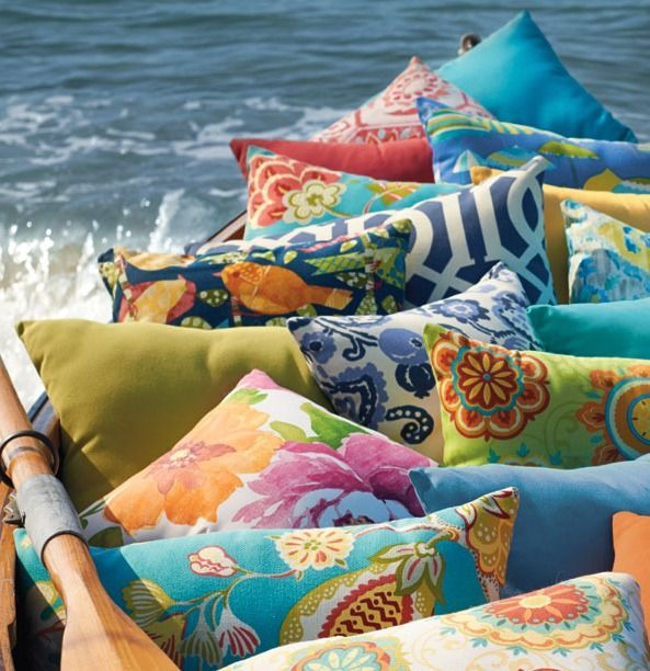Update your outdoor entertaining area by adding colorful pillows.