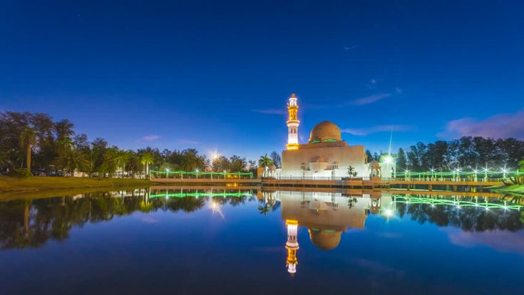 Beautiful and dramatic timelapse of Floating Mosque (Masjid Tengku Tengah Zaharah) Kuala Terengganu, Malaysia. 4K. Motion Time lapse Pan Down.