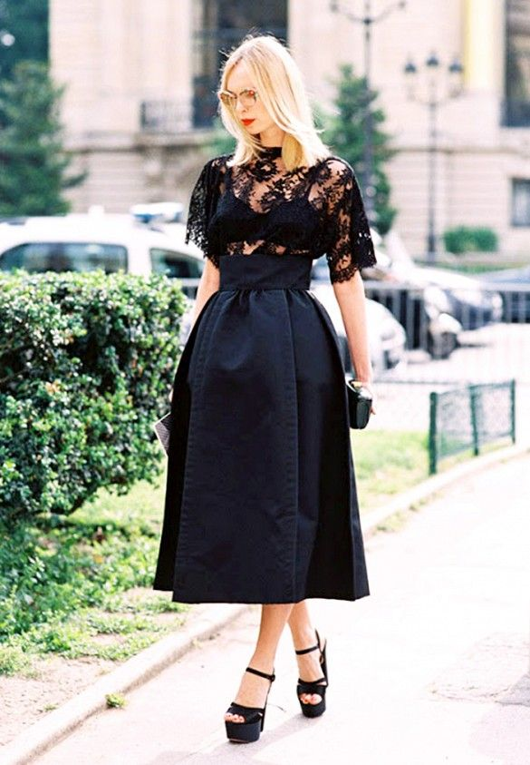 Sheer lace blouse paired with a full satin midi skirt and patent leather platform heels