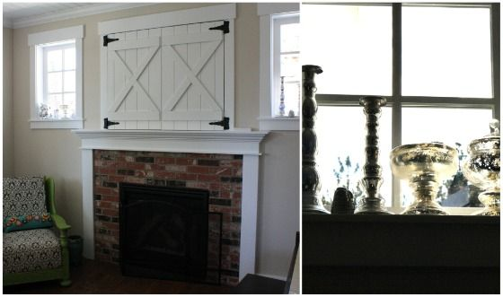 the barn doors over the mantle cover the tv opening.  the windows on either side are filled with mercury glass pieces.