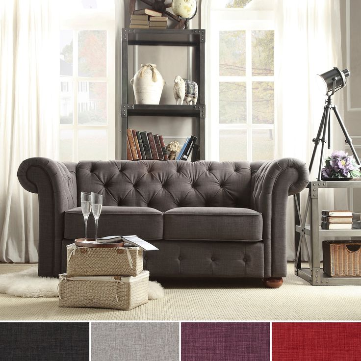 Add graceful seating to you home with this Chesterfield loveseat by TRIBECCA HOME. Showcasing a tufted back and rolled arms in linen, this elegant padded seat sofa can provide plenty of support and comfort in style.