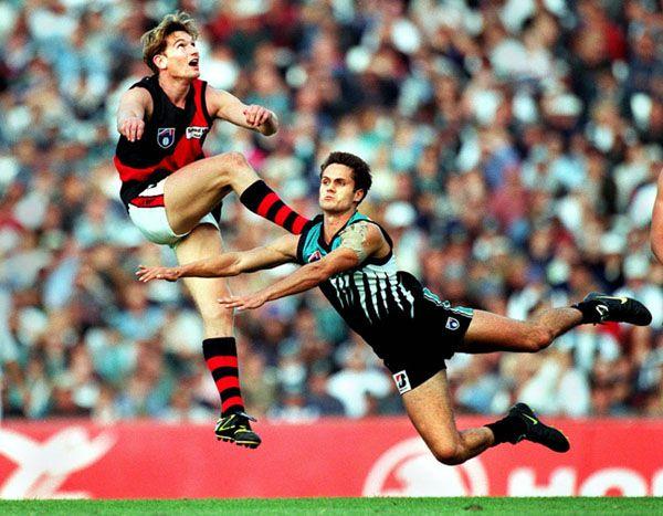 Essendon Bombers (red & black) vs. Port Adelaide Power (teal, white & black)...