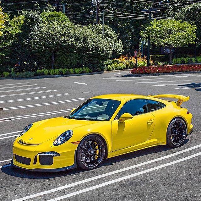 Porsche 991 GT3 in highlighter yellow. My cousin's dream car.