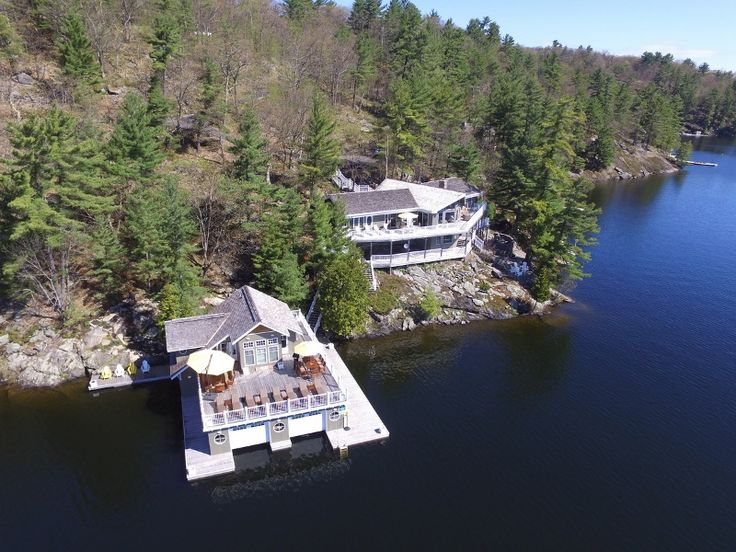 Lake Rosseau, Muskoka cottage, boathouse property for sale. Stunning structures and breathtaking views with fabulous privacy, rock and pine on 382' water frontage and 4.8 acres.