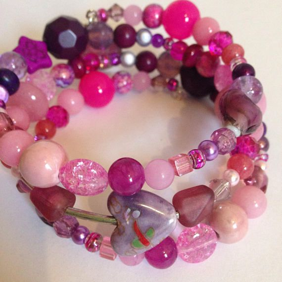Anxiety bracelet, pink & purple bracelet, anxiety aids, fiddle beads, spinner jewelry, believe in love, glass bead bracelet, pink bracelet Pink and purple bracelet made with a stunning selection of glass, quartz, ceramic, howlite, and shell beads. The fiddle section has a
