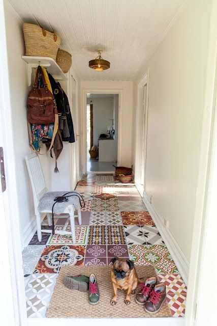 I like this funny floor made with different tiles. Using left over random pieces from friends and family. fun for a mudroom, laundry or even a quirky bathroom.