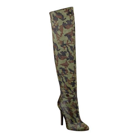 """As seen in the November issue of Essence.....Inspired by the icons of 80's punk, Nine West and Cameron Silver bring you a modern collection with a vintage twist.  Over the knee pointy toe boot.  Full back zipper.  Measurements: heel 4.5"""", shaft 20"""" and circumference 15""""."""