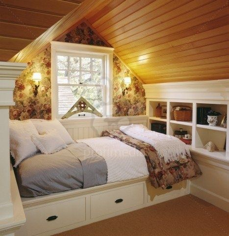 Coziest attic bedroom. Great use of space with the built-in bed/storage. I want this in my attic!