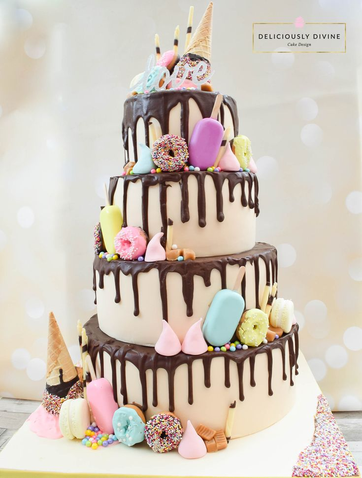 A four tiered chocolate drip wedding cake. Pure indulgence, with donuts, cake lollies, ice cream cones, meringues, macarons and more. A non traditional, unique, unusual and very modern take on a wedding cake. Chocolate lovers heaven coupled with bright popping pastel colours. A really upbeat wedding cake.