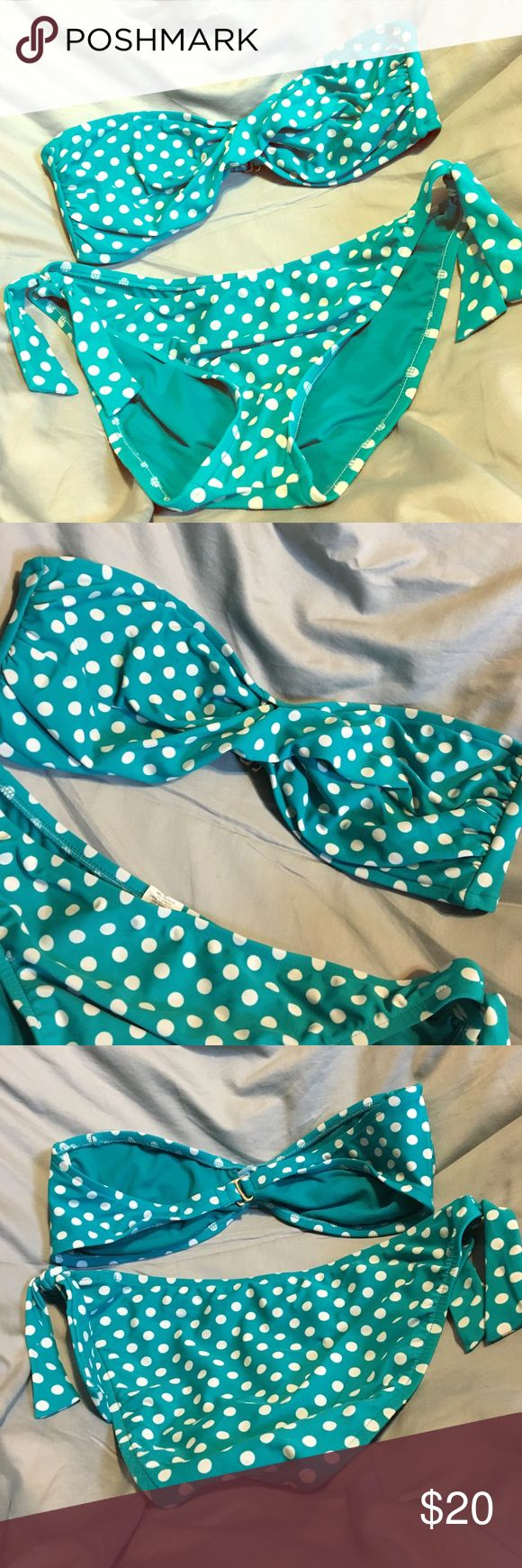Polka Dot Bikini Teal blue and white polka dot bikini. Bandeau top. Regular bottoms. Tie on the side for decoration. Comes with strap for the top. Does not have padding in the top. Both top and bottom are XL Mossimo Supply Co. Swim Bikinis