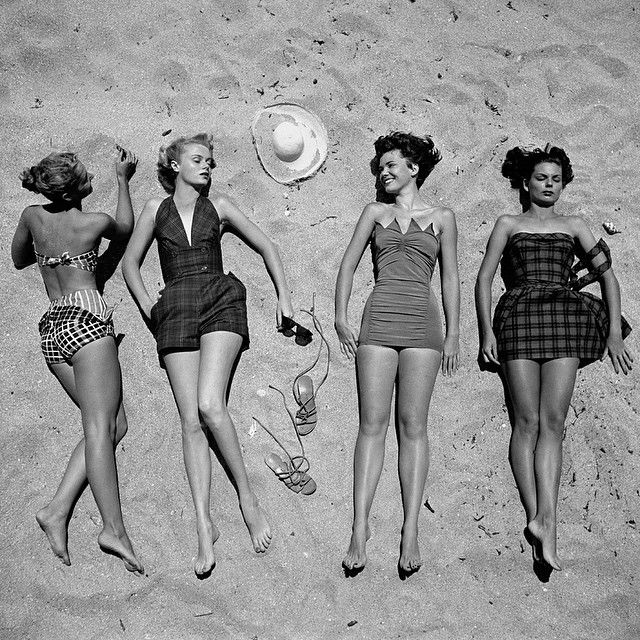 From the May 15, 1950 cover story, Beach Fashion: Two-Piece vs. One-Piece. The bathing suit at left is made of men's cotton handkerchiefs with knots at the side of the trunks. The one-piece was winning in 1950. (Nina Leen—The LIFE Picture Collection/Getty Images) #fashionfriday
