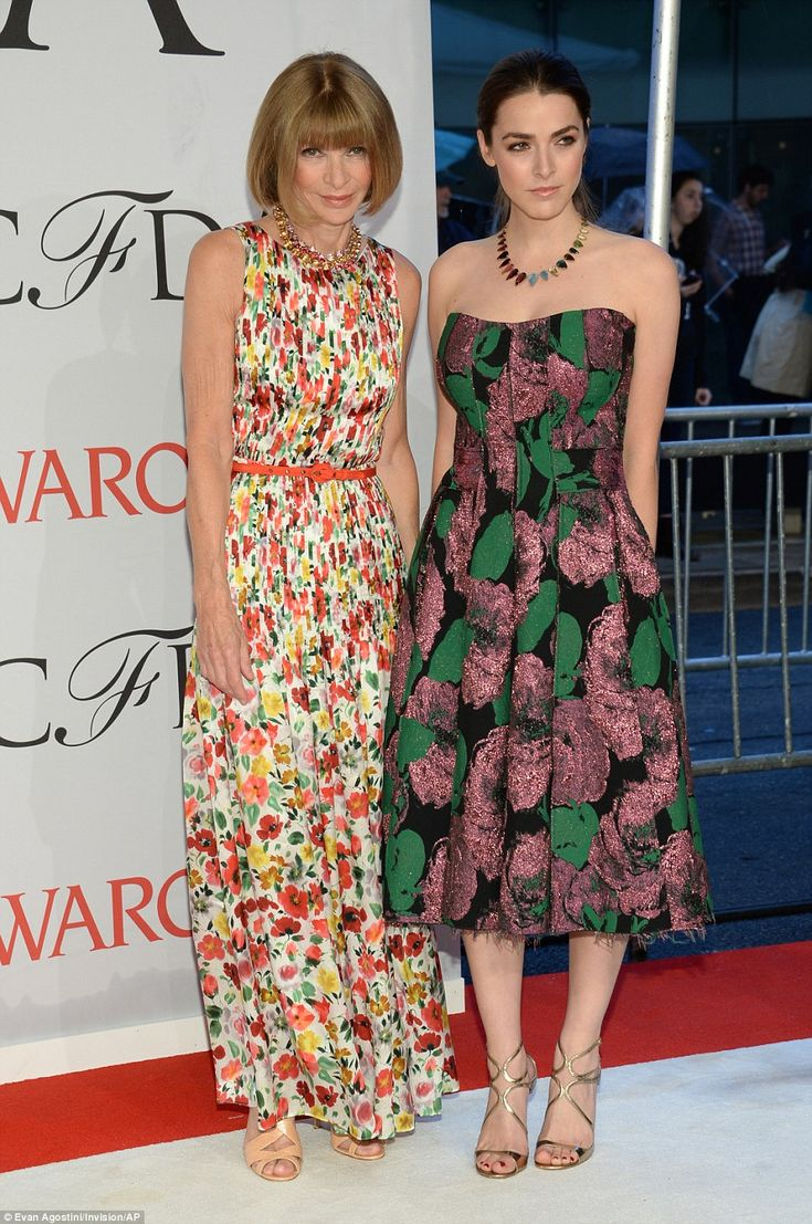 The master and her offspring: Vogue editor Anna Wintour looked proud as she stood with her...