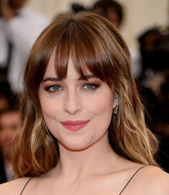 Dakota Johnson sported a girl-next-door wavy 'do with wispy bangs at the Met Gala.: