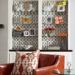 I love the wallpaper. i have a built in china cabinet and i would love to remove the doors and do something cool like this.