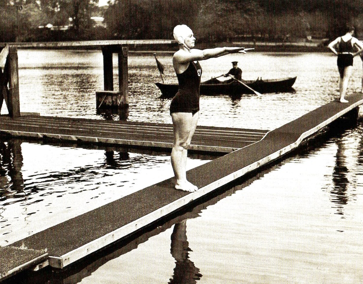 Miss Eva Coleman, who intends to attempt to swim the English Channel this summer, is using Hyde Park Lido, London as a training ground. Picture shows Miss Colman about to take the plunge - 19 may 1932