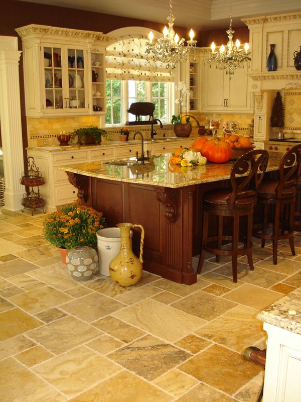 This kitchen is so warm & inviting- partly because of how the wall color helps tie in the stained wood of the island. I really like the floor too. The random sizes & colors make it look casual & custom too.A great room.