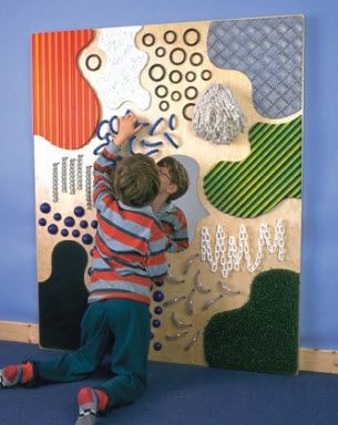Tactile wall with mirror