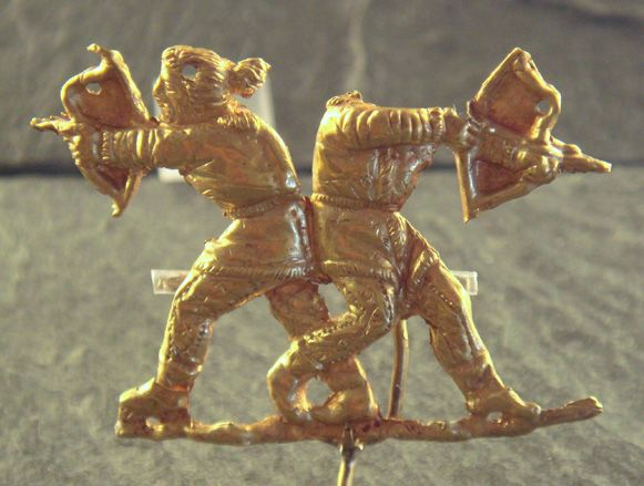 Scythians shooting with bows (gold, Panticapeum, 4th century BC).