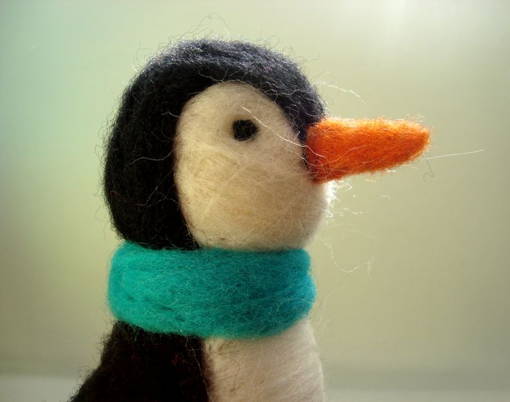 Penguin made with needle felted. The height is 15 cm and width about 10 cm. Made with natural wool.