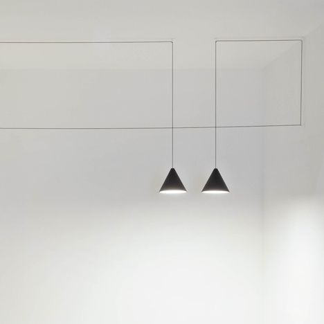London designer Michael Anastassiades presented lamps strung between walls on fine cables for Italian lighting brand Flos