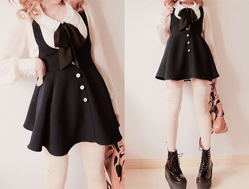 A very cute black dress with the interesting white collar.