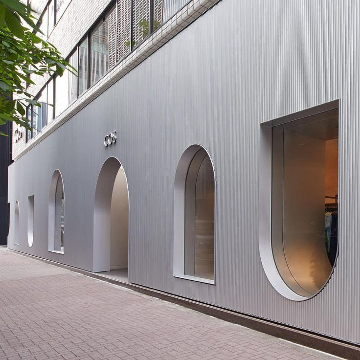 """COS, Ginza, Tokyo, Japan, """"The spacious store features a unique panelled facade with windows inspired by the curved arches and gateways of ancient architecture"""", pinned by Ton van der Veer"""