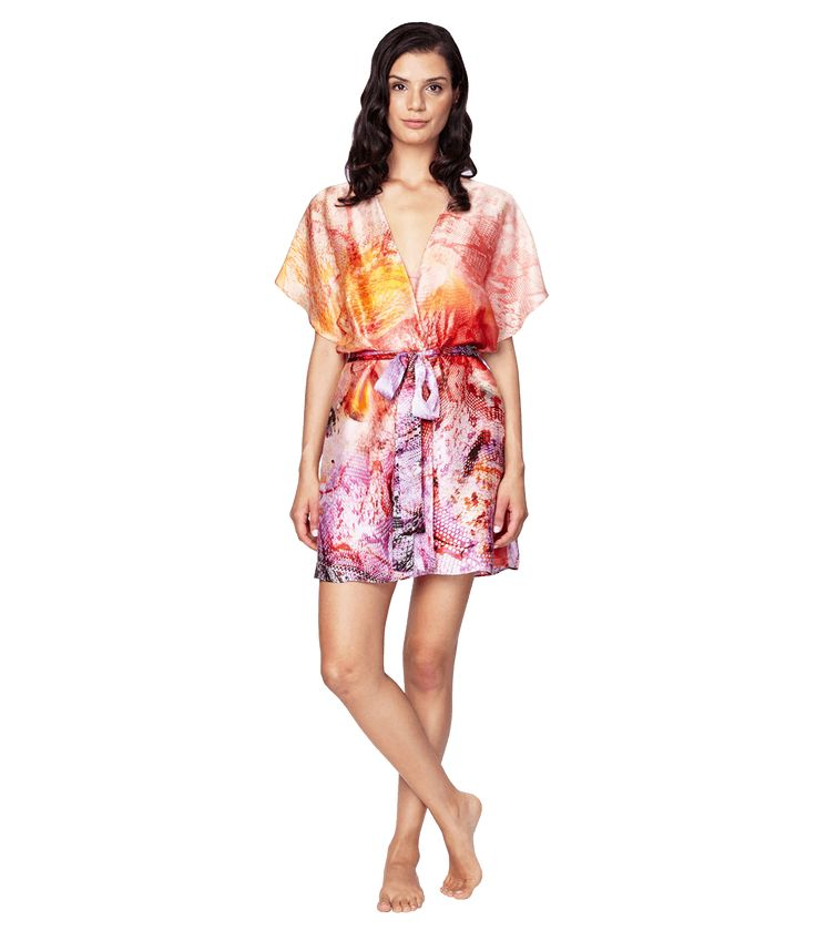Aurora Short Robe: Turn up the heat in the fiery print for summer. Be bold in Sunset orange and pair your flutter-sleeve robe with a flattering pleated cup chemise. 100% Silk. Made in Canada.